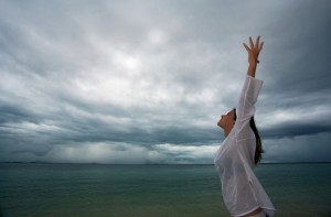 woman looking up at stormy sky